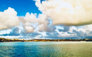 clouds and blue water at Warderick Wells in Exuma